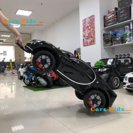 Электромобиль Bugatti Chiron HL318 красный (колеса резина, кресло кожа, пульт, музыка)